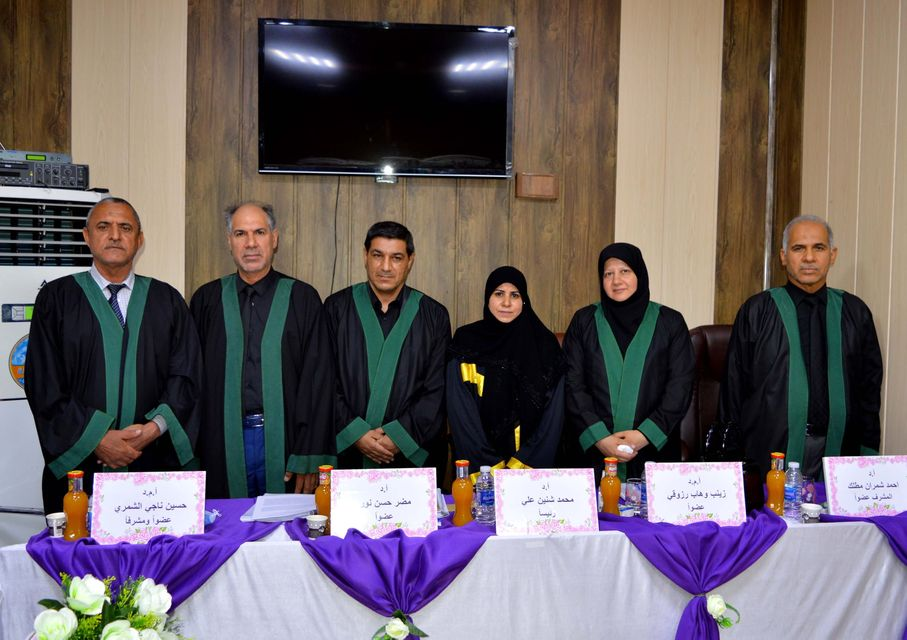 A teacher from the Faculty of Medicine chairs a discussion committee at the University of Babylon