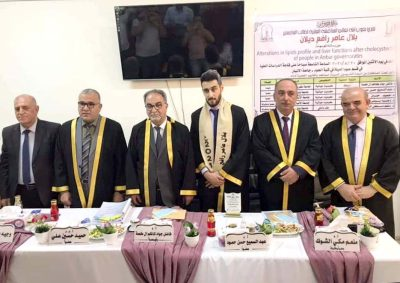 A teacher at the College of Medicine, University of Karbala, chairs a discussion committee at the University of Anbar